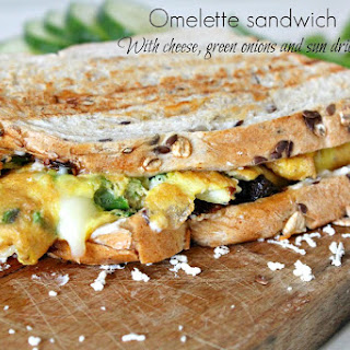 Omelette Sandwich With Sun Dried Tomatoes, Cheese And Green Onions
