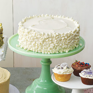 Yellow Cake With Vanilla Frosting and White Chocolate Chips.