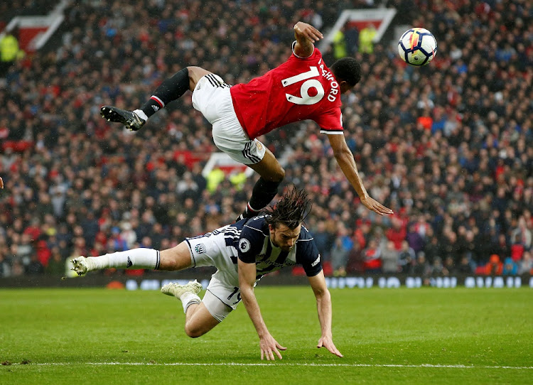 Manchester United's Marcus Rashford in action with West Bromwich Albion's Jay Rodriguez at Old Trafford in Manchester, Britain, April 15 2018. Picture: REUTERS