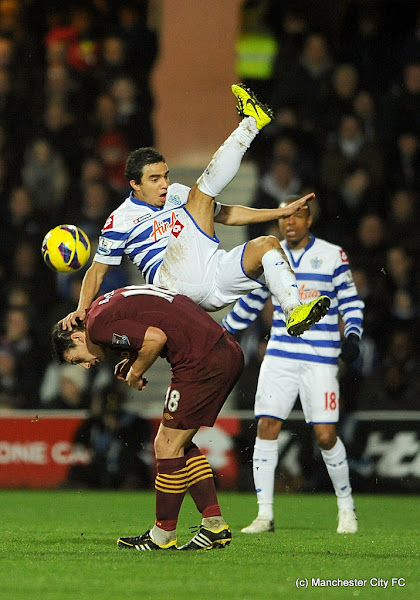 Photo: *ALTERNATE CROP* Manchester City's Fabio jumps above Manchester City's Gareth Barry