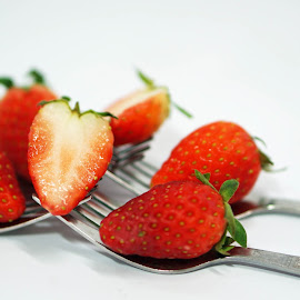 Strawberry as dessert by Alice Chia - Food & Drink Fruits & Vegetables ( fork, red, green, whole, 5, strawberries, halves )