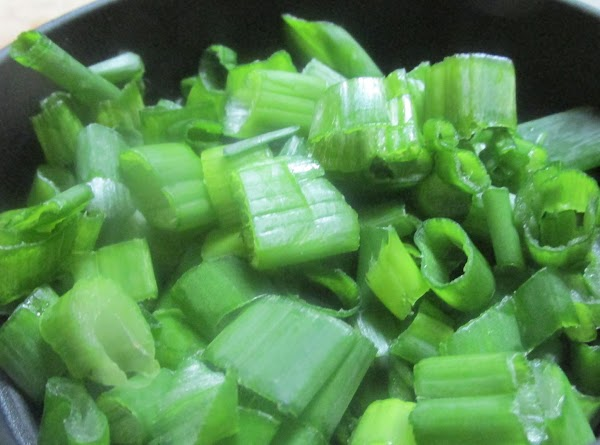 Add chopped green onion tops or parsley and spices,then add chicken broth.
