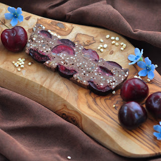 Smooth Chocolate Cake With Cherries And Puffed Quinoa.