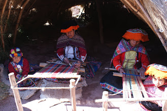 Photo: Women from different communities wear hats of different designs that designate their tribe.