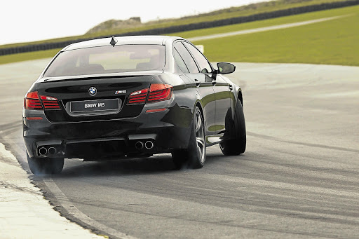 ON TRACK: The M5 has the agility of a much smaller vehicle on the racetrack
