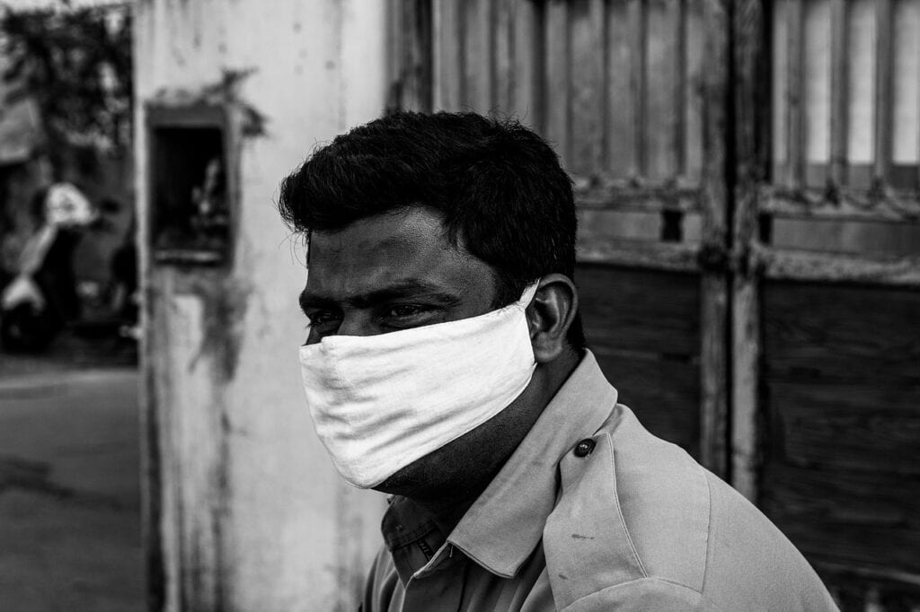 Man from India wearing a facemask