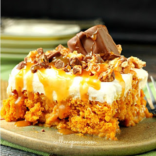 Skinny Pumpkin Snickers Poke Cake With Whipped Cream Frosting.