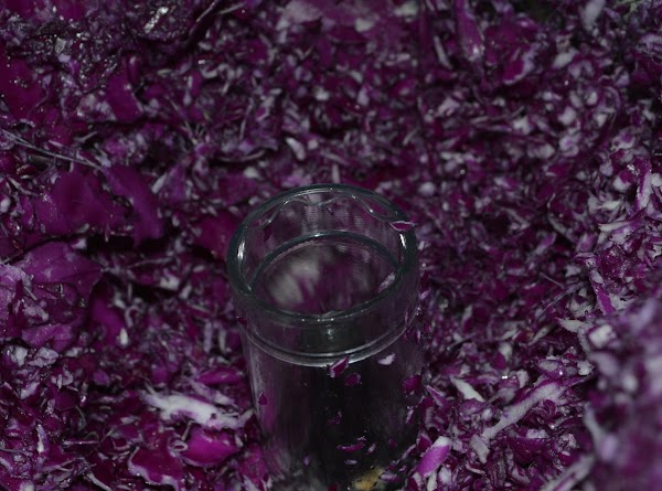 Shred cabbage with grater or food processor.