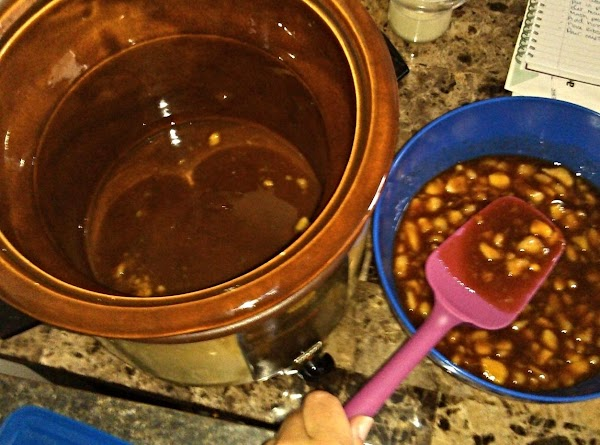 Pour water into crockpot and add one spoonful of sauce.  Spread to cover...