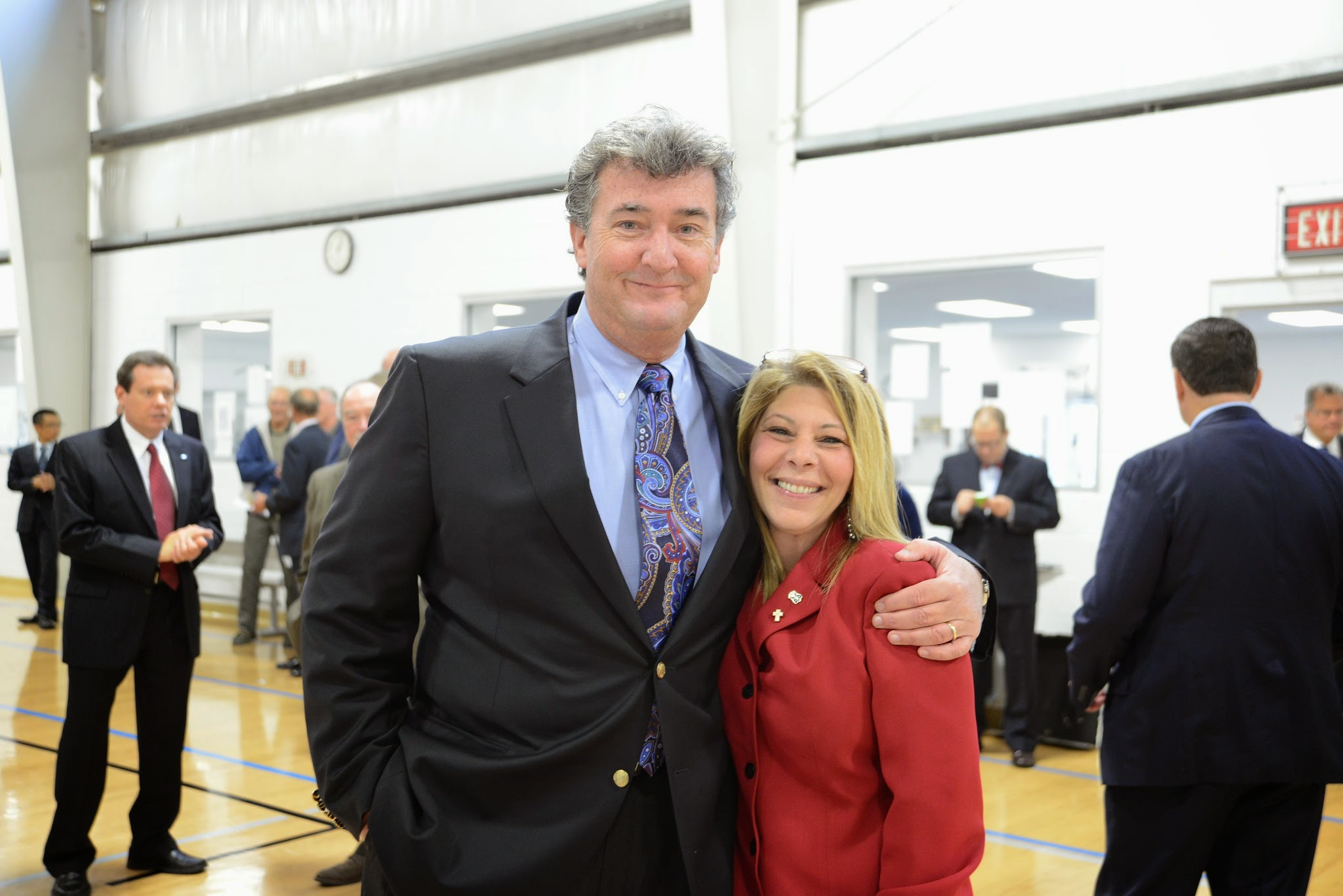 Photo: Reps. Robert Craven and Doreen Costa attend the commissioning of Toray Plastics' co-generation facility in North Kingstown on September 25, 2014.