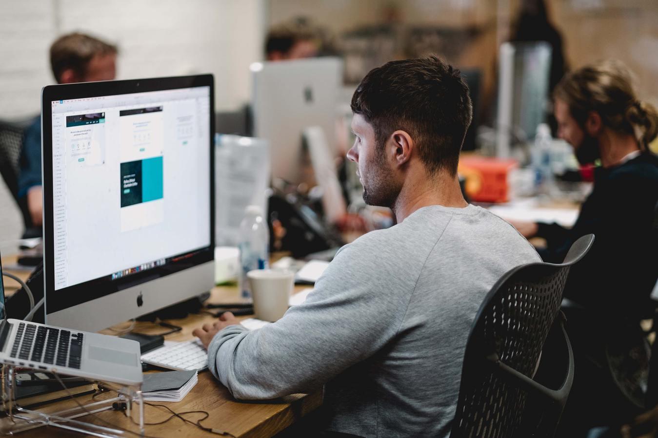 Man Designer Working on Desktop Computer