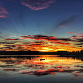 lake sunset by Rob King - Landscapes Sunsets & Sunrises ( clouds, reflection, color, sunset, lake, boat )