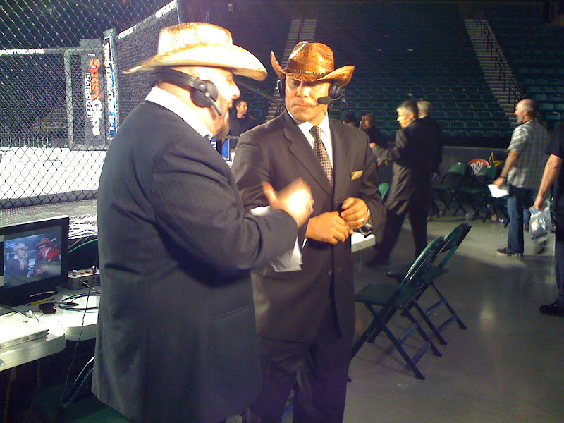Photo: Announcers wearing cowboy hats.  We must be in Texas.