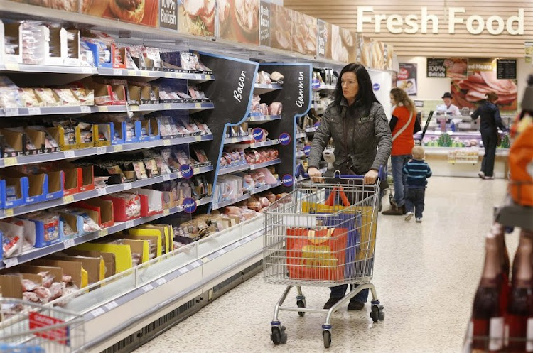 Customers shop at a Tesco store in Bishop's Stortford, Britain. Picture: REUTERS