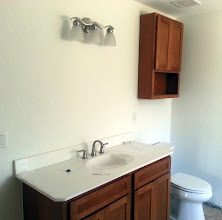Photo: December 21, 2012 The guest bathroom's shaping up, too. The cabinet on the wall was a last-minute addition.