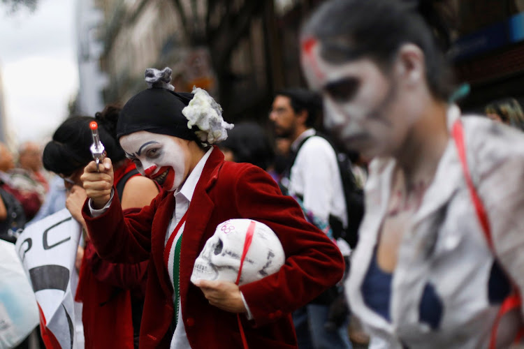 A demonstrator in Mexico City gestures during a march marking the 50th anniversary of the 1968 student massacre by Mexican armed forces.