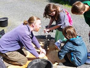 Photo: Matthew and class build a mushroom log