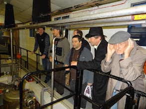 Photo: Ed strains to hear the tour guide over the machinery at Black Sheep.