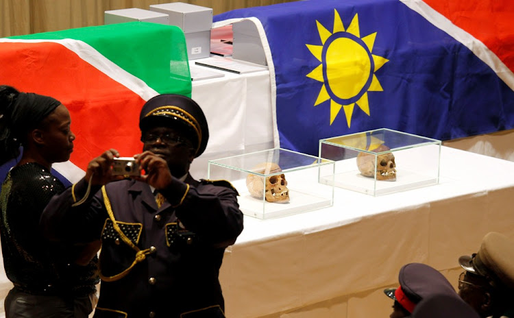 A member of a delegation from Namibia takes a photograph in front of human skulls from the Herero and ethnic Nama people in Berlin, Germany, in 2011. Picture: REUTERS