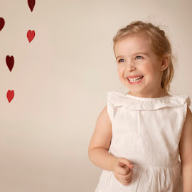 My Valentine by Patricia Wouterse - Babies & Children Child Portraits ( studio, hearts, fineart, girl, dress, valentine )