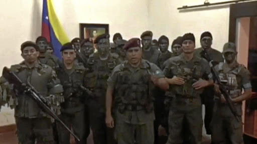 A still image from video released by Operation David Carabobo purportedly shows a group of men dressed in military uniforms announcing uprising in Valencia, Venezuela, on August 6 2017. Picture: OPERATION DAVID CARABOBO/HANDOUT VIA REUTERS