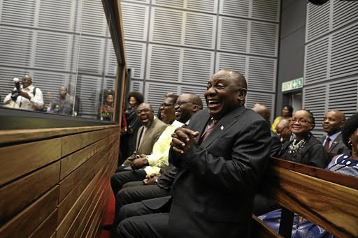 President Cyril Ramaphosa sits in a mock court session at the official opening of the Booysens magistrate's court in Oakdene, Johannesburg.