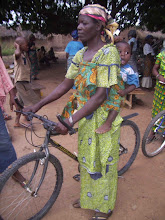 Photo: Momori is a piito brewer who lives in Guri in Jirapa district, 40 miles north of Wa, where the pavement ends. Momori buys millet, one of the ingredients for her business, at the local market. She would walk to the market, often 6-8 miles round trip, and carry the grain home on her head.
