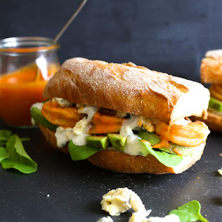 Grilled Buffalo Shrimp and Avocado Sandwiches with Blue Cheese Sauce.