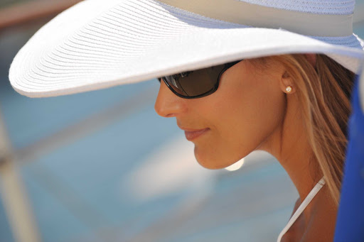 Ponant-woman-hat.jpg - Sail the South Pacific in style on a Ponant cruise.