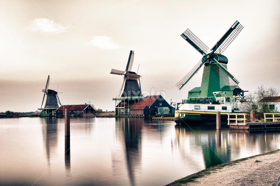 Windmills at Zaanse Schans by Anneke Reiss - Digital Art Places ( water, mill, building, sky, zaan, zaanse schans, sunset, holland, dutch, windmill, sun )