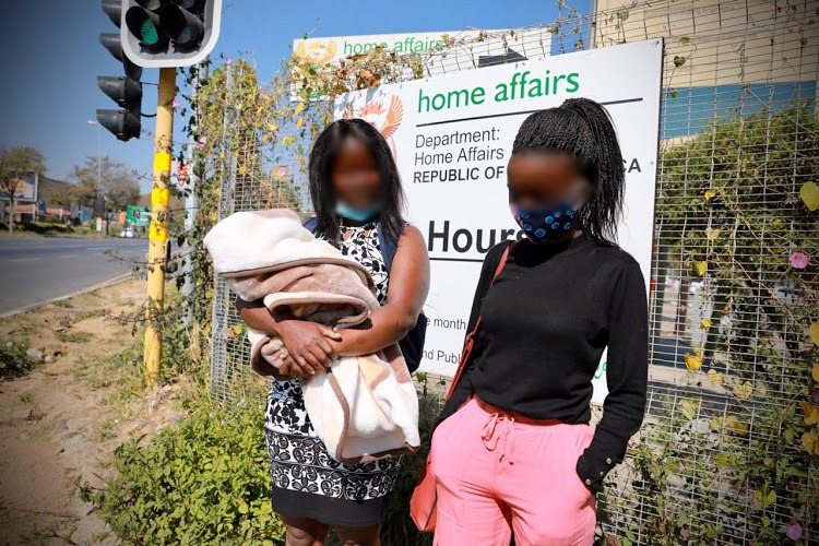 Mpho and Tebogo at the Randburg home affairs offices. Their faces are obscured to protect the identity of the 17-year-old mother.
