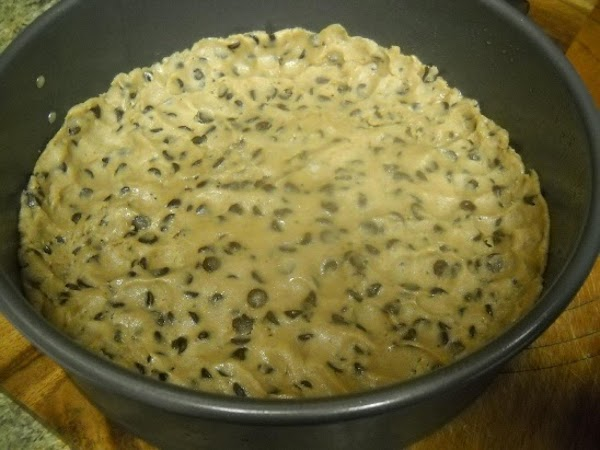 Press your cookie dough into the bottom and slightly up the sides of the...