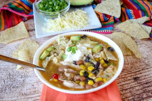 Chicken Tortilla Soup In A Bowl With Toppings.