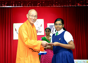 Photo: Vijaya Varshini, who has done well in PSLE, receiving the Award from Swamiji