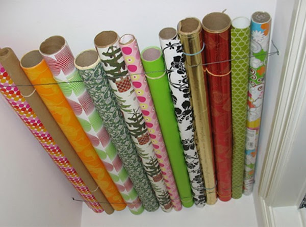 Use wire to make a space to store gift wrap rolls against the ceiling, rather...