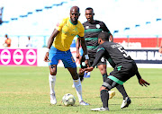 Anthony Laffor of Mamelodi Sundowns is challenged by Wandisile Letlabika of Bloemfontein Celtic during their Absa Premiership  match at Loftus Versfeld Stadium in Pretoria yesterday.