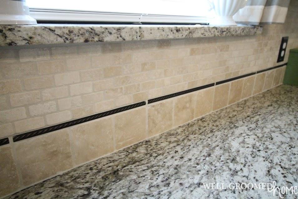 tumbled marble backsplash