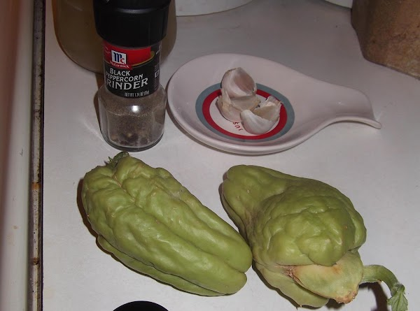 Cut chayote in half, remove seed; peel and cut into thin slices.