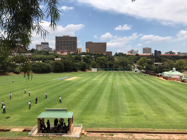 Schoolchildren kick a ball on the grounds of Parktown Boys' High School in Johannesburg on January 17 2020. Parents have expressed concern at the seeming laxity surrounding the death of a boy while on a school camp.