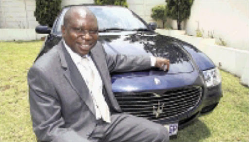 ENJOYING LIFE'S PLEASURES: Patrick Banda bought himself a Maserati Quatroporte worth a cool R1,4 million. 14/12/08. Pic. Simphiwe Nlwali. © Unknown.
