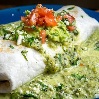 Wet Chicken Burrito With Creamy Poblano Sauce.