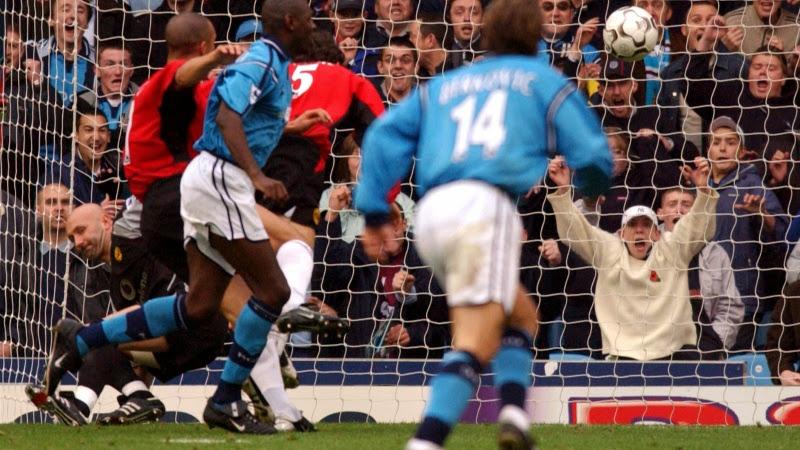 Photo: Manchester City's Shaun Goater flicks the ball past Manchester United goalkeeper Fabien Barthez to score their third goal