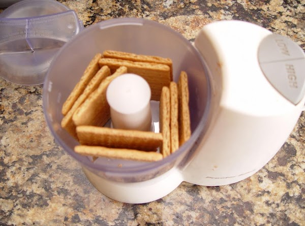 Throw crackers into a food processor and crush into crumbs (or crush in a...