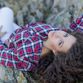 Beautiful girl with curly hair stand on the rocks by Dragos Iancu - People Portraits of Women ( beautiful, shirt, curly, rocks, girl, jeans )