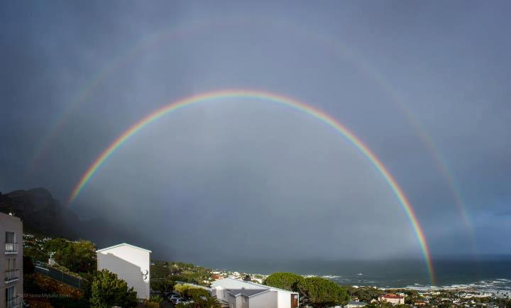"Photo: ""It's not everyday that you wake up to a complete double rainbow - Pano of @campsbay_com "" -Mike Eloff  See all the photos from Mashable's Weather Photo Challenge: http://on.mash.to/KpPiNv"