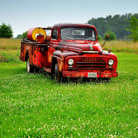 by Emily Vickers - Transportation Automobiles ( automobiles, old, side of the road, yard, grass, truck, green, tennessee, georgia, transportation, south carolina, junk, north carolina, trucks, mountains, southern, red, cars, south, rust, antique )