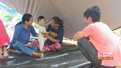 Photo: Mae Ai: Mother and baby Ploy with Healthcare volunteer, Daeng. and Arm