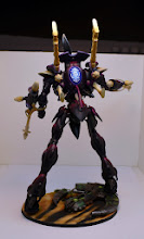 Photo: Eldar Wraithknight standing a recently destroyed Necron Vehicle.