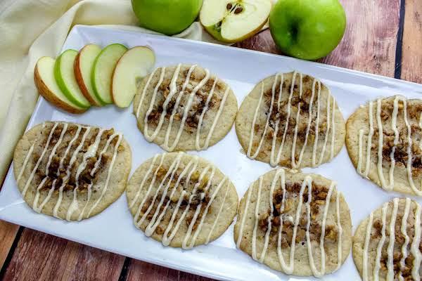 A Plate Of Glazed Caramel Apple Pecan Pinwheel Cookies.