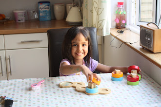 Photo: Inaya baking some muffins.
